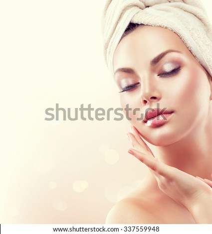 Spa Woman. Beautiful Girl After Bath Touching Her Face. Perfect Skin. Skincare. Young Skin. Cleansing