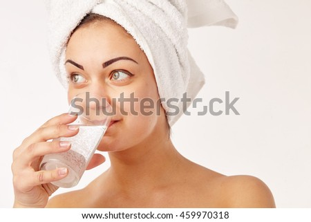 Spa woman. Beautiful girl is drinking water - stock photo