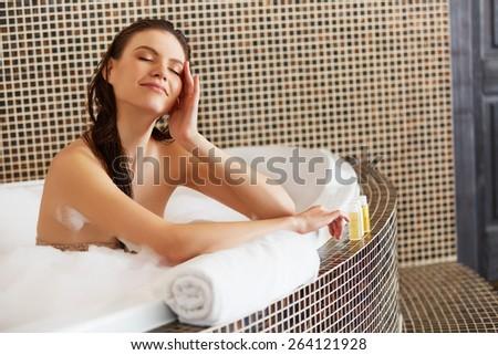 Spa Woman. Beautiful Girl Touching Her Face. Perfect Skin. Skincare. Young Skin - stock photo