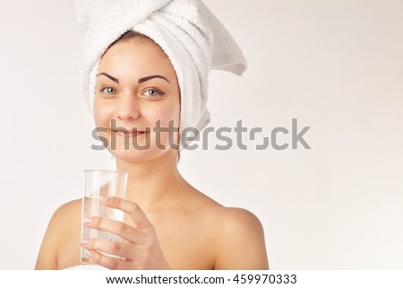 Spa woman. Beautiful girl with glass of water