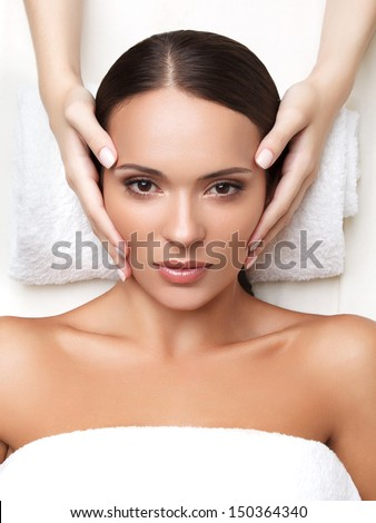 Spa Woman. Close-up of a Young Woman Getting Spa Treatment. Face Massage