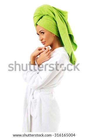 Spa woman in bathrobe and towel on head. - stock photo