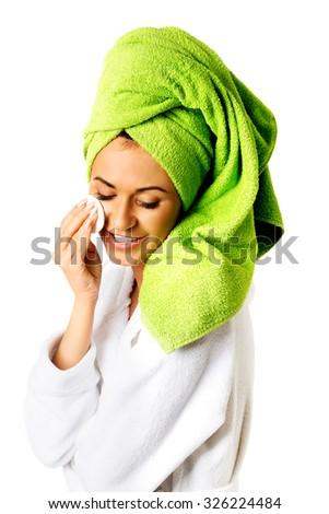 Spa woman in bathrobe removing makeup. - stock photo
