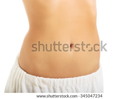 Spa woman in towel showing her slim belly.