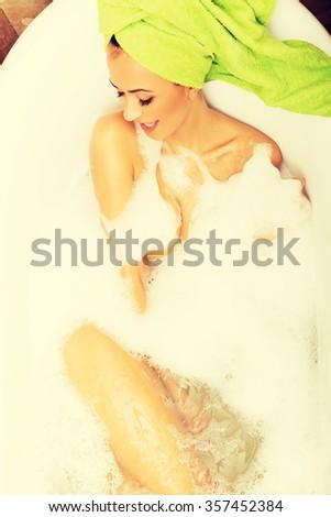 Spa woman relaxing in bath.  - stock photo