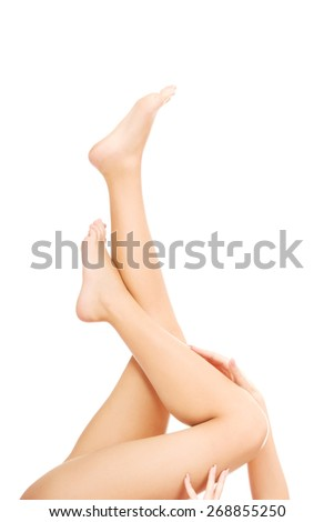 Spa woman touching her slim legs. - stock photo