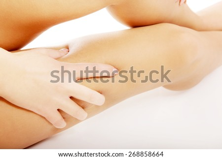 Spa woman touching her thigh. - stock photo