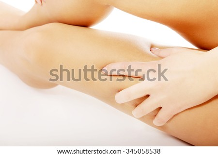 Spa woman touching her thigh.