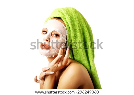 Spa woman with face mask and towel on head. - stock photo