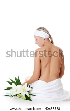 Spa Woman with flowers of a lily isolated - stock photo