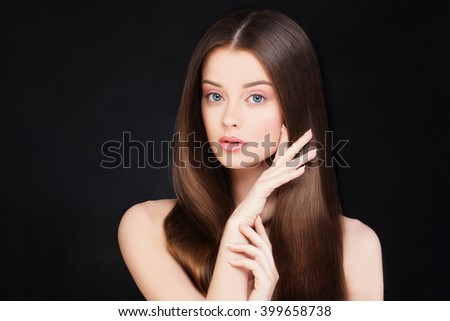 Spa Woman with Healthy Hair and Natural Make-up on Black Background - stock photo