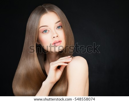 Spa Woman with Long Healthy Hair on Dark. Beautiful Model with Shiny Hairstyle. Young Beauty