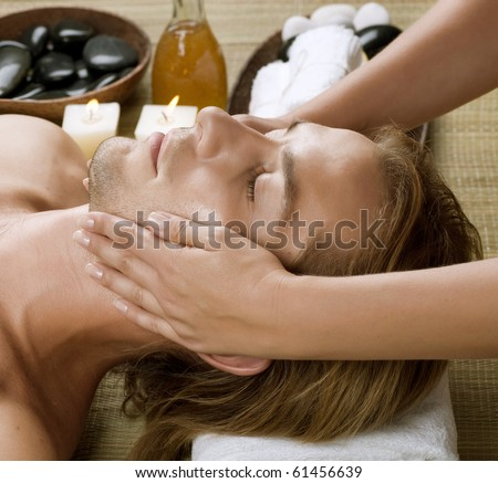 Spa.Young Man getting Face Massage