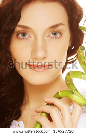 SPA. young woman with bamboo. - stock photo