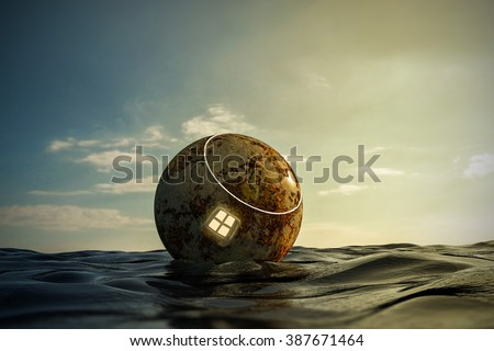 space capsule floating on the sea - stock photo