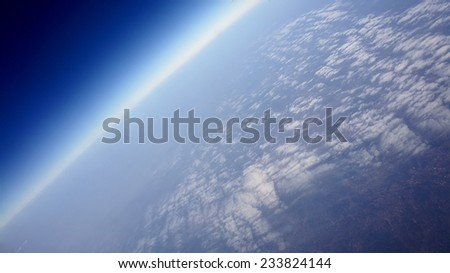 space clouds. view from the window of an airplane flying in the clouds - stock photo