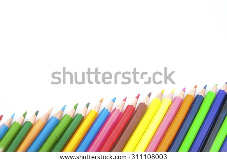 Space colourful pencils isolated on white background close up