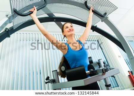Space Curl - Patient at the physiotherapy making physical exercises with special equipment - stock photo