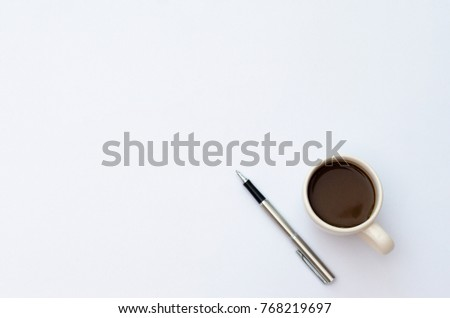 Space on the desk  Area space enter text. mockup coffee cups snack candy,  Pen note paper Placed on a White table top view desk table with a lot of things on it top view with copy space