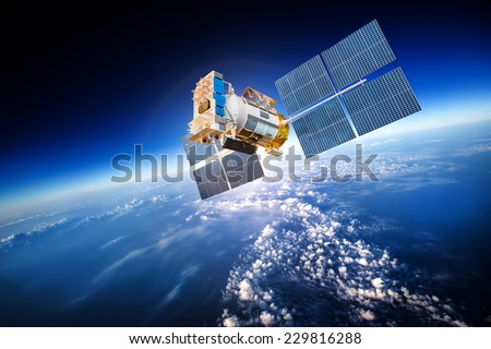 Space satellite orbiting the earth. Elements of this image furnished by NASA - stock photo