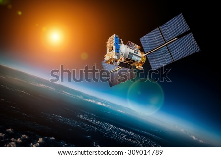 Space Satellite Orbiting Earth On Background Stock Photo ...