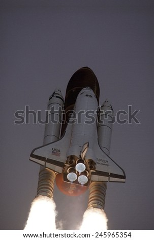 Space Shuttle Discovery launched with Hubble Space Telescope in its cargo bay. April 24, 1990.