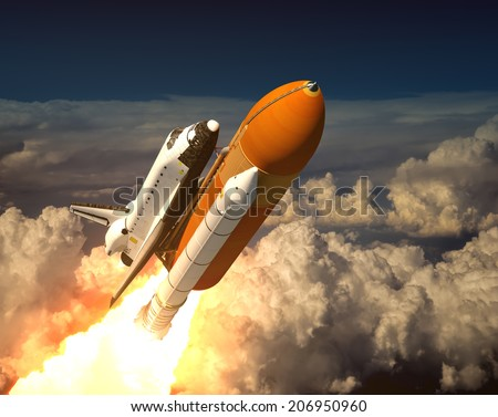 Space Shuttle In The Clouds - stock photo