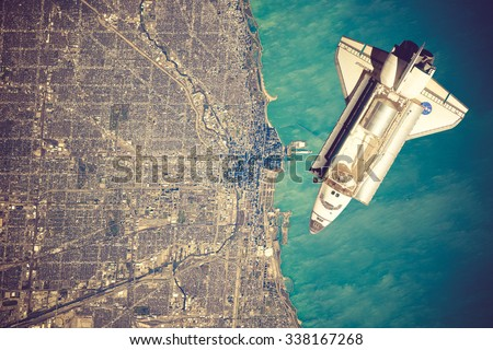 Space Shuttle orbiting the earth. Elements of this image furnished by NASA.vintage color - stock photo