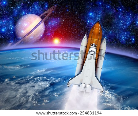 Space shuttle rocket launch earth spaceship saturn. Elements of this image furnished by NASA. - stock photo