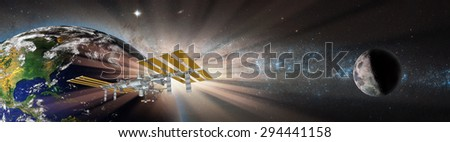 "Space station in orbit around Earth against milky way.""Elements of this image furnished by NASA"