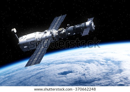 Space Station Over Earth. 3D Scene. (NASA IMAGES NOT USED) - stock photo