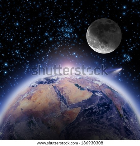 Space sunrise with Moon, Comet and stars. Good morning world! Elements of this image furnished by NASA.  - stock photo