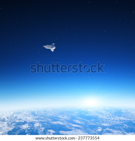 Space sunrise with NASA shuttle and background stars. Elements of this image furnished by NASA. - stock photo