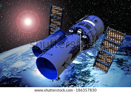 Space Telescope Over Earth  - stock photo