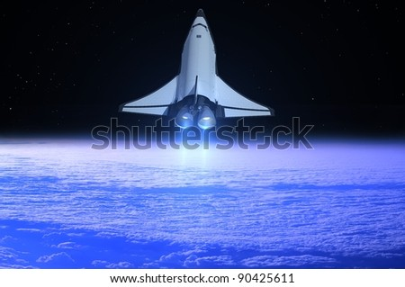 Space transport on a background of the sky - stock photo