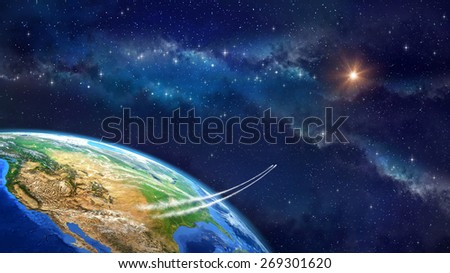 Space travel. Very high definition picture of planet earth in outer space. Spacecrafts lifting off from USA soil. Elements of this image furnished by NASA - stock photo