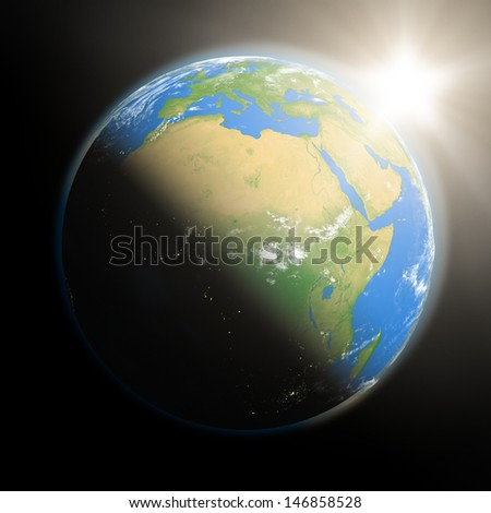 Space view of the sun rising over Africa on blue planet Earth. Elements of this image furnished by NASA. - stock photo