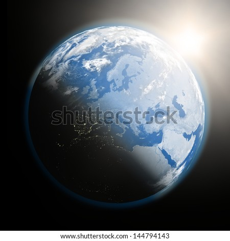 Space view of the sun rising over Europe on blue planet Earth. Elements of this image furnished by NASA.