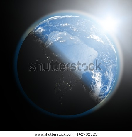 Space view of the sun rising over South America on blue planet Earth. Elements of this image furnished by NASA.