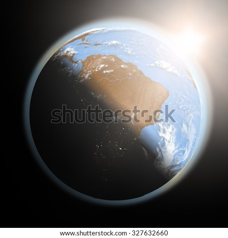 Space view of the sun rising over South America on planet Earth. Elements of this image furnished by NASA.