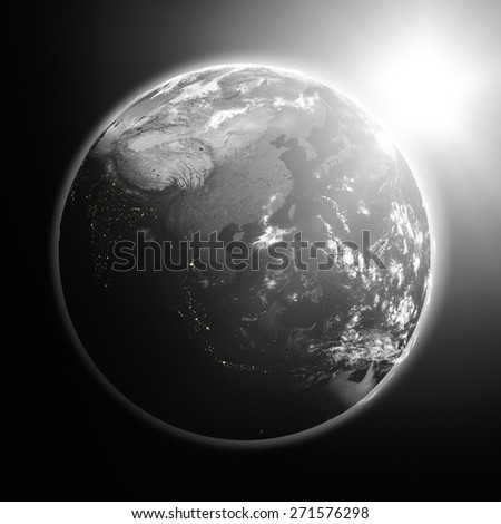 Space view of the sun rising over southeast Asia on black planet Earth. Elements of this image furnished by NASA. - stock photo