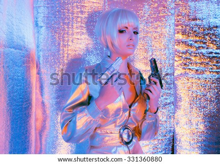 Space war woman holding gun wearing jump suit and sunglasses. Standing in reflective solar room. - stock photo