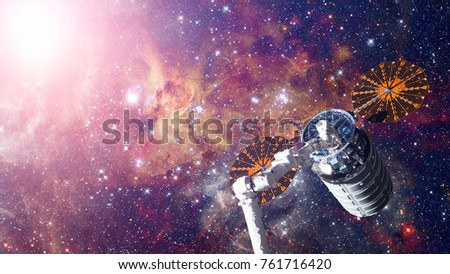 Spacecraft Launch Into Space. Elements of this image furnished by NASA.