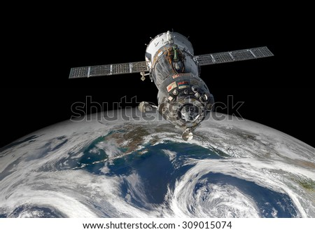 Spacecraft Soyuz orbiting the earth. Elements of this image furnished by NASA. - stock photo