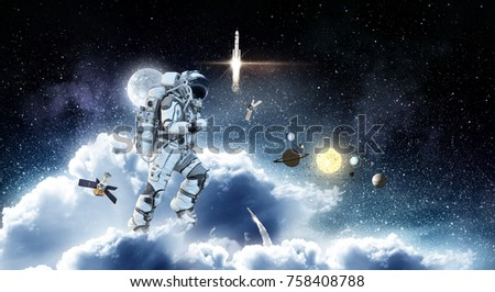 Spaceman run on clouds. Mixed media