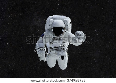 Spaceman travels on a background of stars. Astronaut outer space - stock photo