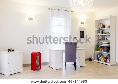 Spacious and bright room for a teenager, with a set of classic white furniture