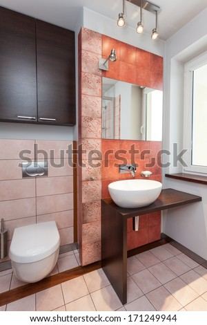 Spacious apartment - Interior of modern bathroom with vessel sink - stock photo