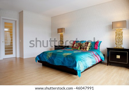 spacious bedroom with modern furniture - stock photo