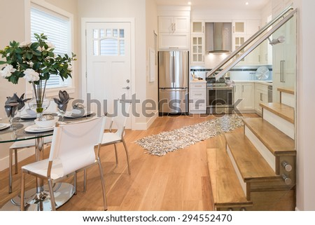 Spacious bright living room and dining room with leather chairs. Interior design. - stock photo